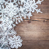 Christmas snowflakes on wooden background — Stockfoto