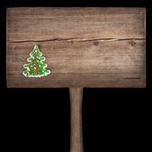 Christmas green fir tree on a wooden board. New Year background — Foto Stock