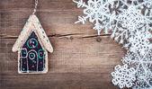 Christmas snowflakes on wooden background — Stock Photo