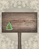 Árvore de Natal verde abeto em uma placa de madeira. fundo de ano novo — Fotografia Stock