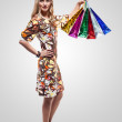 Fashion Sexy Girl in dress, full length Portrait. Woman with Shopping Bags. — Stock Photo