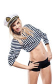 Young Beautiful Adorable Woman in sea peak-cap and stripped vest. Girl - Captain's in sexy sailor T-shirt. Studio shot. — Stock Photo