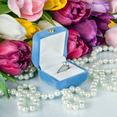 Bouquet of beautiful tulips flowers and wedding ring with diamond — Stock Photo