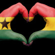 Heart and love gesture by hands colored in ghana flag for touris — Stock Photo #10492763