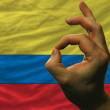 Ok gesture in front of ccolombia national flag — Stock Photo