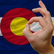 Ok gesture in front of colorado us state flag — Stock Photo