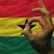 Ok gesture in front of ghana national flag — Stock Photo