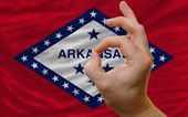 Ok gesture in front of arkansas us state flag — Stock Photo