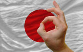 Ok gesture in front of japan national flag — Stock Photo