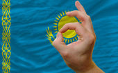 Ok gesture in front of kazakhstan national flag — Stock Photo