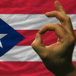 Ok gesture in front of puerto rico national flag — Photo