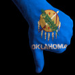 Stock Photo: Oklahomus state flag thumbs down gesture for failure made with
