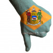 Stock Photo: Delaware us state flag thumbs down gesture for failure made with