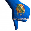 Oklahoma us state flag thumbs down gesture for failure made with — Stock Photo