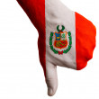 Stock Photo: Peru national flag thumbs down gesture for failure made with han