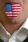 Man tongue painted in usa flag symbolizing to knowledge to speak — ストック写真