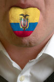 Man tongue painted in ecuador flag symbolizing to knowledge to s — Stock Photo
