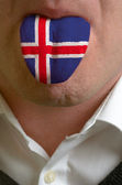 Man tongue painted in iceland flag symbolizing to knowledge to s — Stock Photo