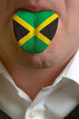 Man tongue painted in jamaica flag symbolizing to knowledge to s — Stock Photo