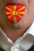 Man tongue painted in macedonia flag symbolizing to knowledge to — Stock Photo