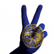 Nebraskus state flag two finger up gesture for victory and win — Stock Photo #12576935