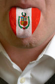 Man tongue painted in peru flag symbolizing to knowledge to spea — Stock Photo