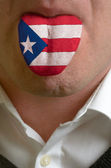 Man tongue painted in puerto rico flag symbolizing to knowledge — Stock Photo