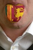 Man tongue painted in sri lanka flag symbolizing to knowledge to — Stock Photo