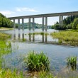 Beautiful lake with viaduct crossing over it — Stockfoto