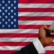 Cell phone in front  national flag of america — Stock Photo