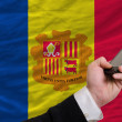 Cell phone in front  national flag of andorra - Stock Photo