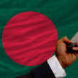 Cell phone in front  national flag of bangladesh — Stock Photo