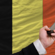 Cell phone in front national flag of belgium — Stock Photo #23917579