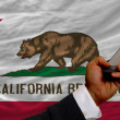 Cell phone in front flag of american state of california — Stock Photo #23919309