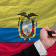 Cell phone in front  national flag of ecuador - 图库照片