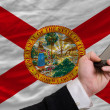 Cell phone in front  flag of american state of florida    — Stock Photo