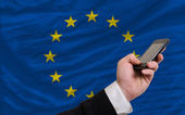 Cell phone in front national flag of europe — Stock Photo