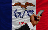 Cell phone in front flag of american state of iowa — Stock Photo