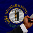 Cell phone in front  flag of american state of kentucky — Stok fotoğraf