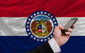 Cell phone in front flag of american state of missouri — Стоковое фото