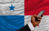 Cell phone in front national flag of panama — Stok fotoğraf