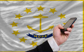 Cell phone in front flag of american state of rhode island — Stock Photo