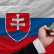 Cell phone in front  national flag of slovakia - Stock Photo