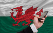 Cell phone in front national flag of wales — Стоковое фото