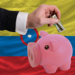Dollar into piggy rich bank and  national flag of columbia — Lizenzfreies Foto