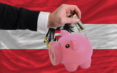 Dollar into piggy rich bank and national flag of austria — 图库照片