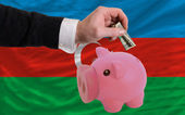 Dollar into piggy rich bank and national flag of azerbaijan — 图库照片