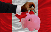 Dollar into piggy rich bank and national flag of canada — 图库照片