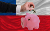Dollar into piggy rich bank and national flag of chile — Stock Photo