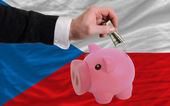 Dollar into piggy rich bank and national flag of czech — 图库照片
